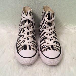Converse high top lace ups in a zebra print. Cute!